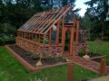 Redwood greenhouse on brick base in Port Orchard WA
