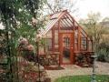 Redwood greenhouse on stone base