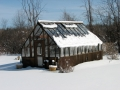 Home greenhouse in snow