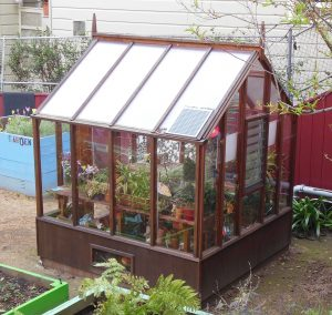 Small greenhouse with twinwall polycarbonate in roof, Glass walls
