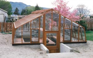 The base of this greenhouse is below ground level for maximum insulation and reduced exposure to wind