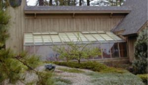 This greenhouse is below ground level and protected on three sides by the house